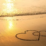 bigstock-Hearts-drawn-on-the-sand-of-a-43411627