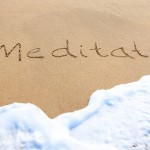 bigstock-Meditate--Written-In-The-Sand-38103802