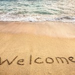bigstock-Welcome-Word-On-The-Sand-55915133
